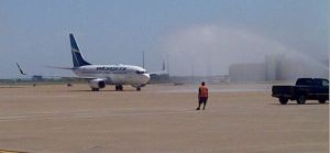 "WestJet Flight 1554 receives the inaugural ""Shower of Affection"" at DFW International Airport."