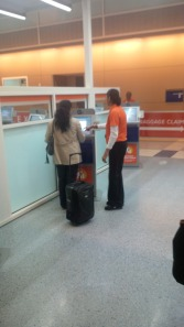 Passenger receives assistance using the new Automated Passport Control system